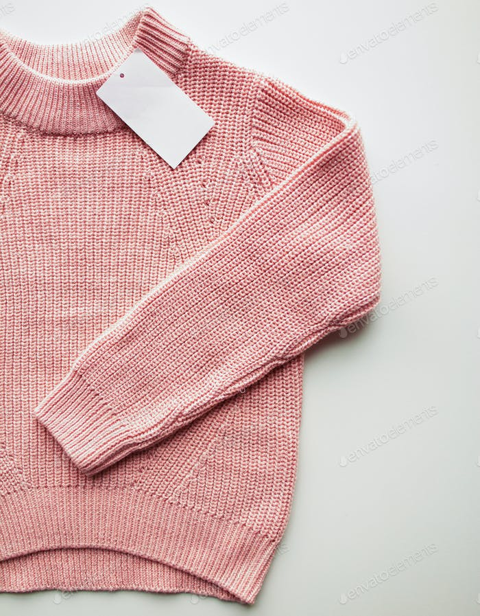 close up of sweater or pullover with price tag