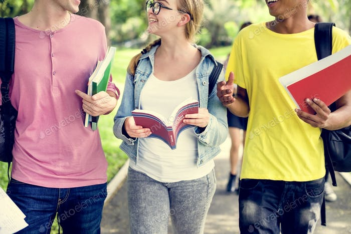 Diverse Young Students Book Outdoors Concept