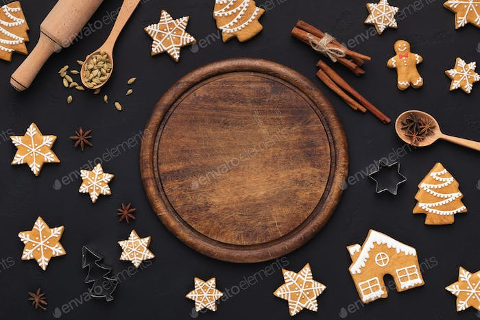 Christmas background with assorted cookies and wooden board