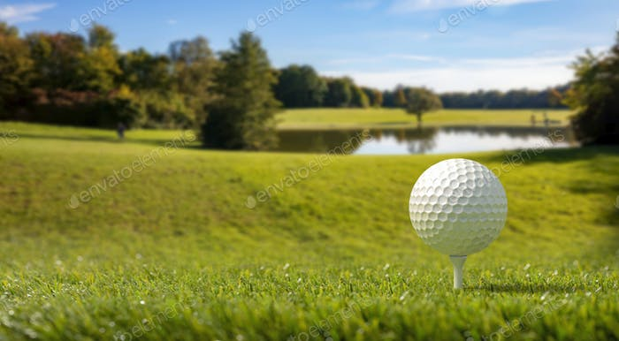 Golfball on green grass golf course, trees and a small pond, blue sky background. 3d illustartion