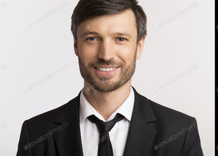 Smiling Businessman Looking At Camera On White Background, Isolated