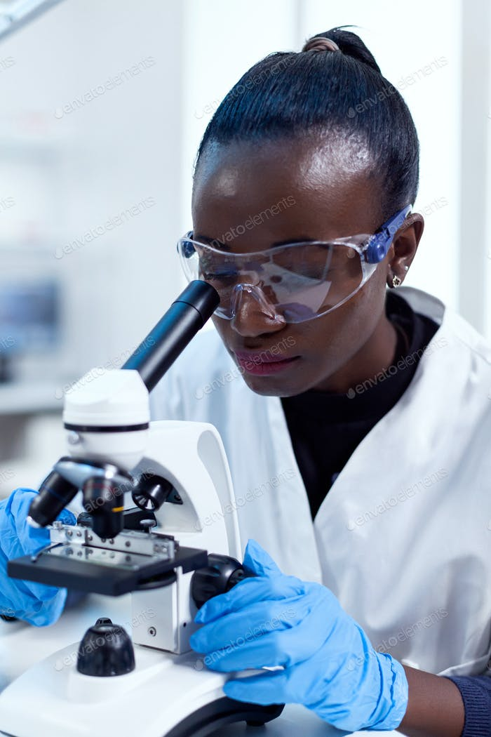 Close up of chemist of african ethnicity doing sample analysis