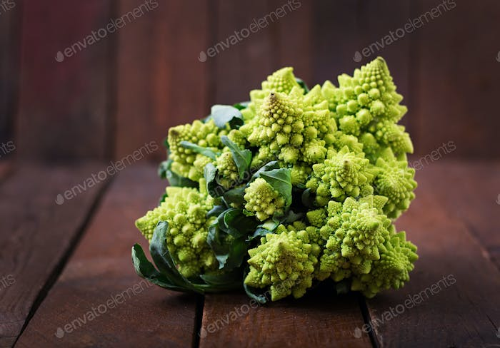 Cabbage romanesco on a dark wooden background