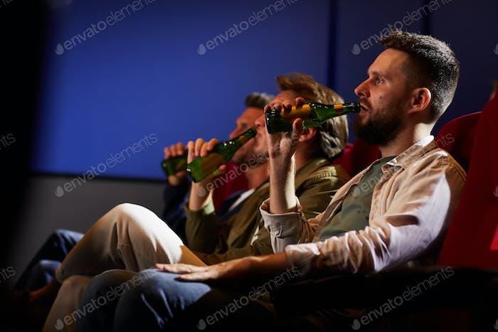 Men Drinking Beer in Cinema