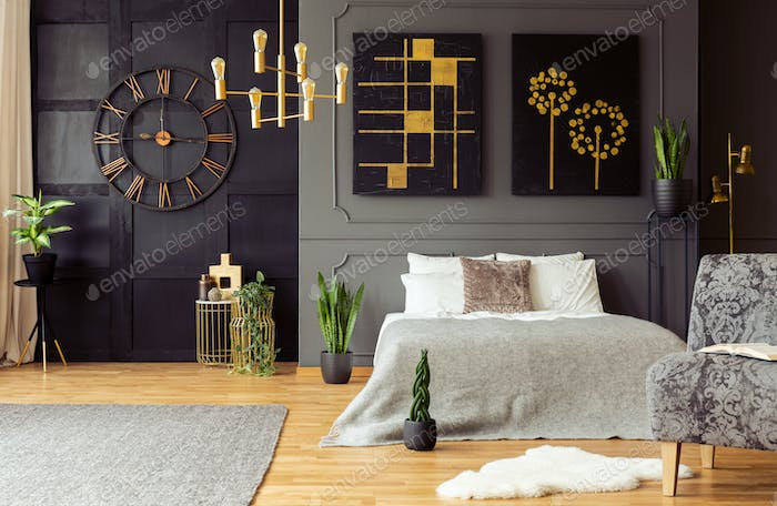Real photo of golden accents, clock, paintings, plants and doubl