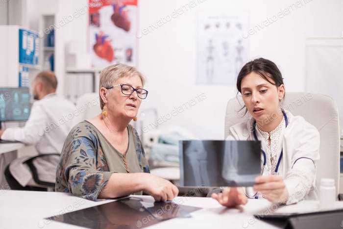 Doctor discussing with senior patient