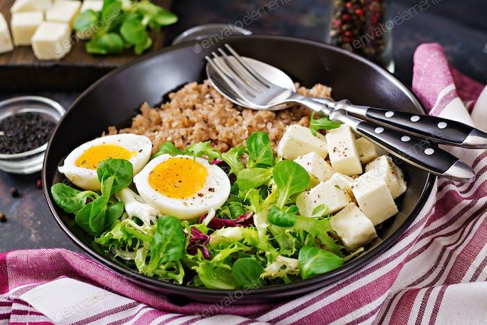Healthy breakfast with egg, cheese, lettuce  and buckwheat porridge