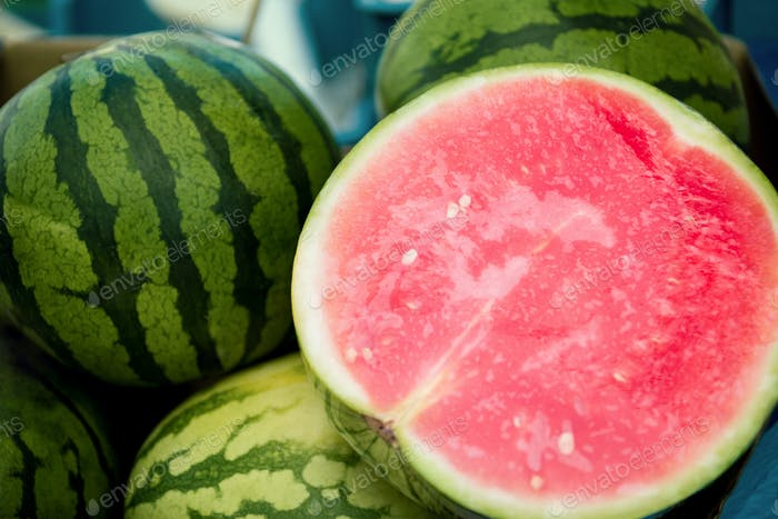 close up view of half of watermelon and watermelons