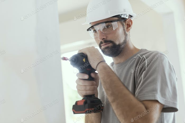 Professional repairman using a drill