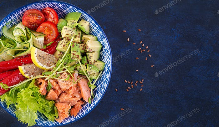 Healthy grilled salmon, avocado, tomato, cucumber, paprika and chia seeds.
