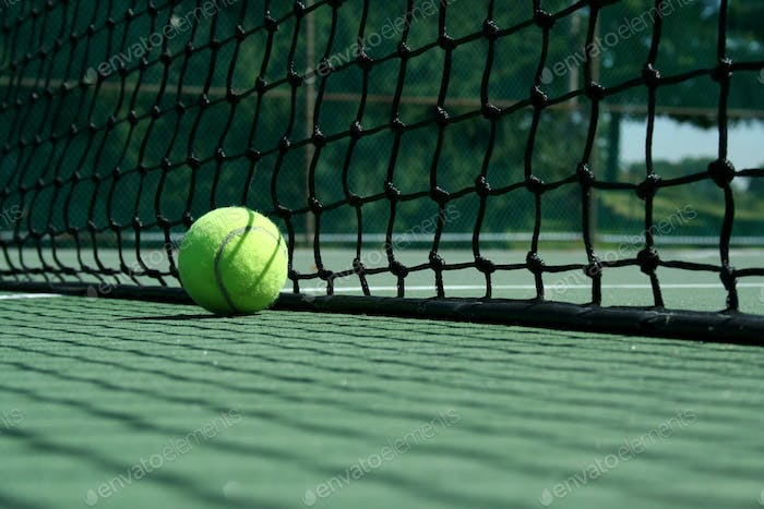 Tennis ball near net