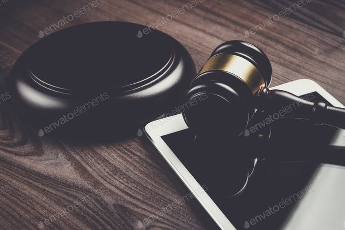 judge gavel and tablet computer