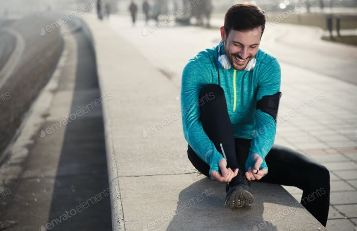 Sportsman fitness exercising while running and jogging outdoor