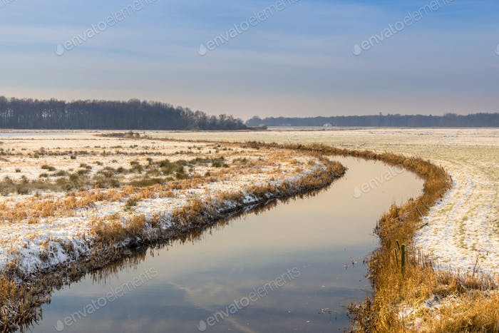Lowland river winter landscape