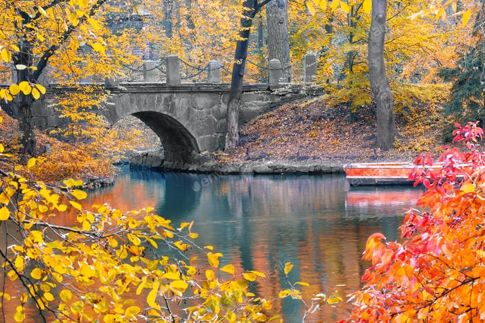 Stone bridge in the park in autumn