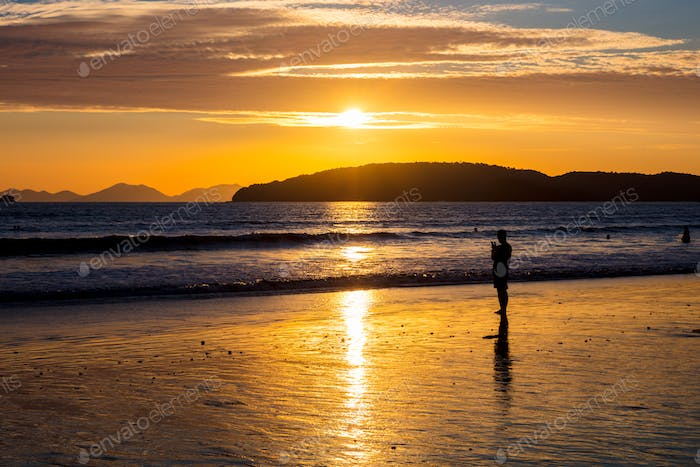 Silhouette Woman At Beach During Sunset