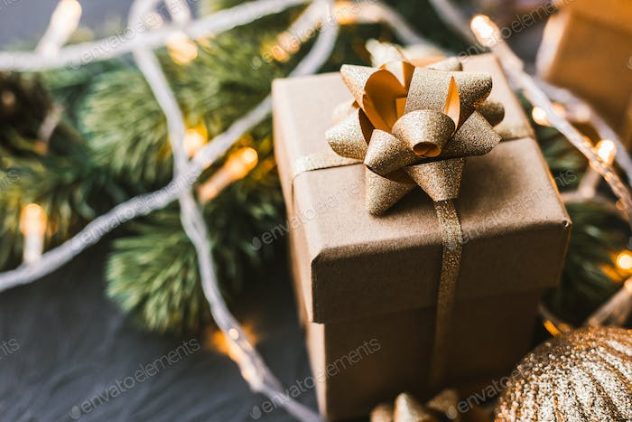 Christmas presents on a black background. Christmas background with fir tree, garlands, gifts.