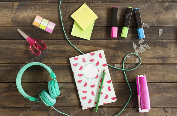 Office supplies and headphones on desk