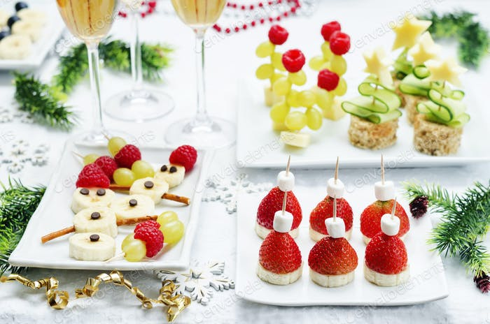 Assortment of New Year's snacks and a glass of champagne