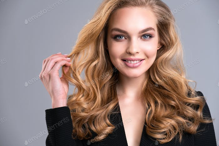 Beautiful face of an attractive model with blue eyes.