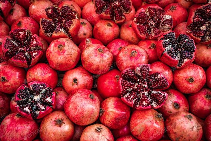 Many pomegranate cut in half, pomegranate background