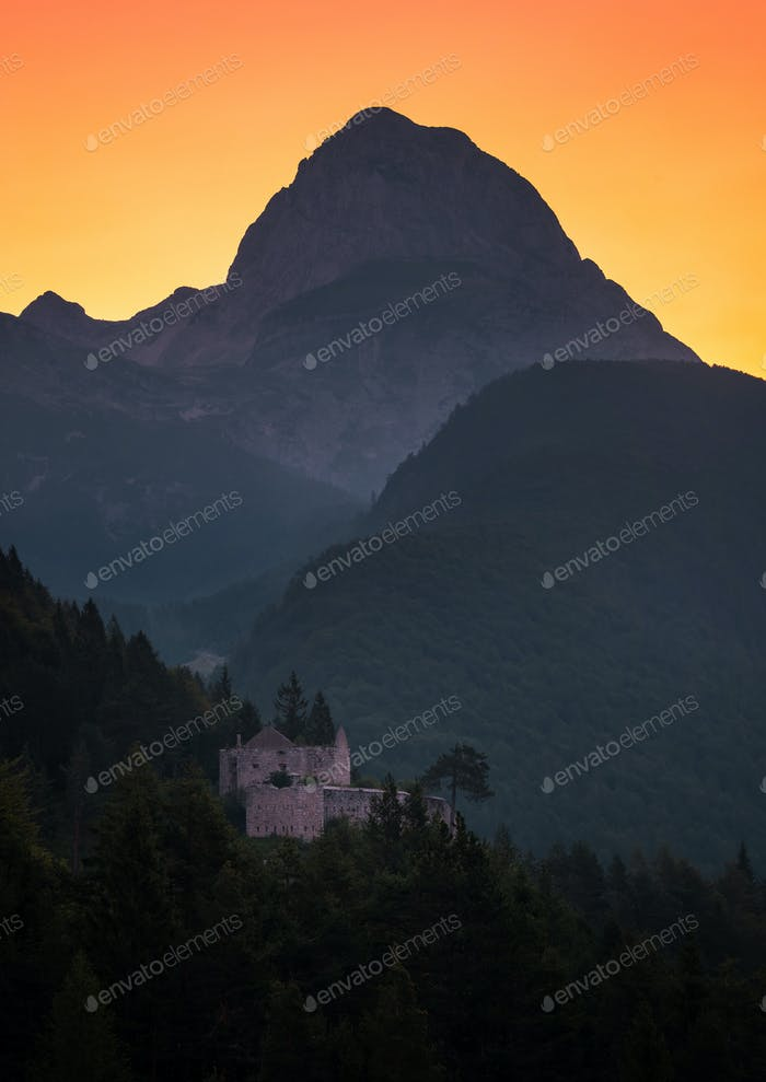 Castle below the Mangart mountain at sunrise