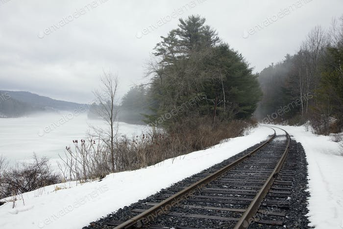 A railway track, train tracks in the snow