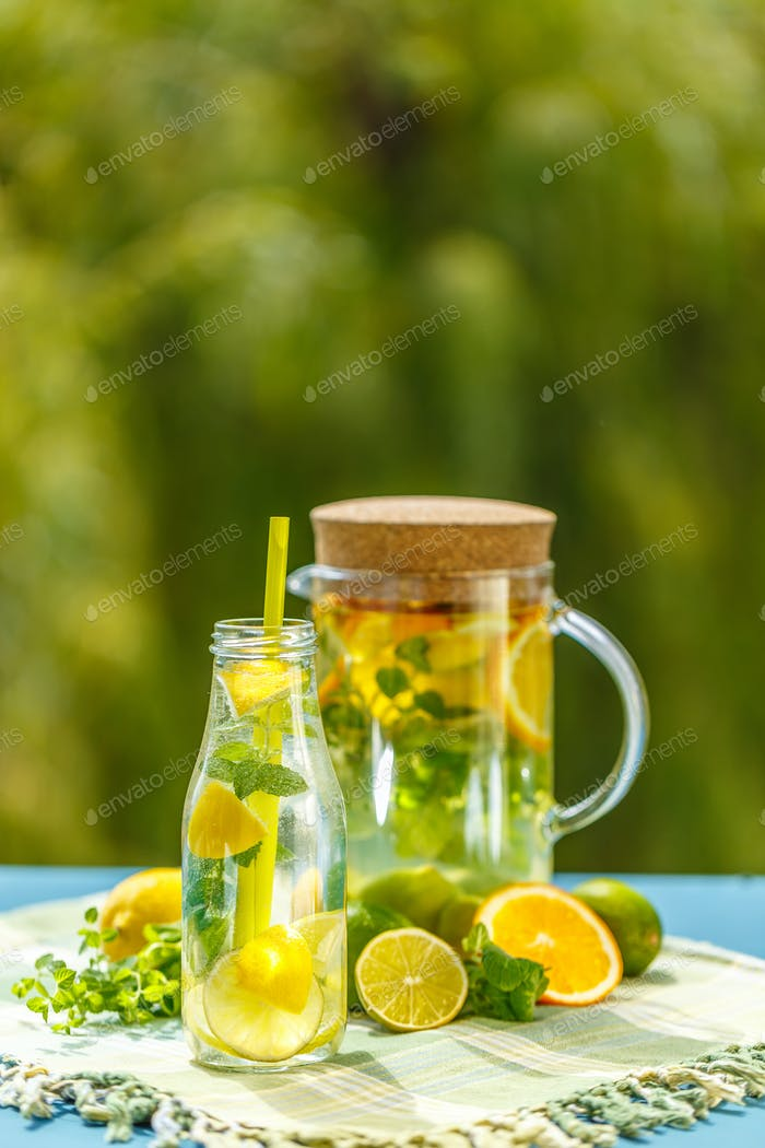 Lemonade pitcher with lemon