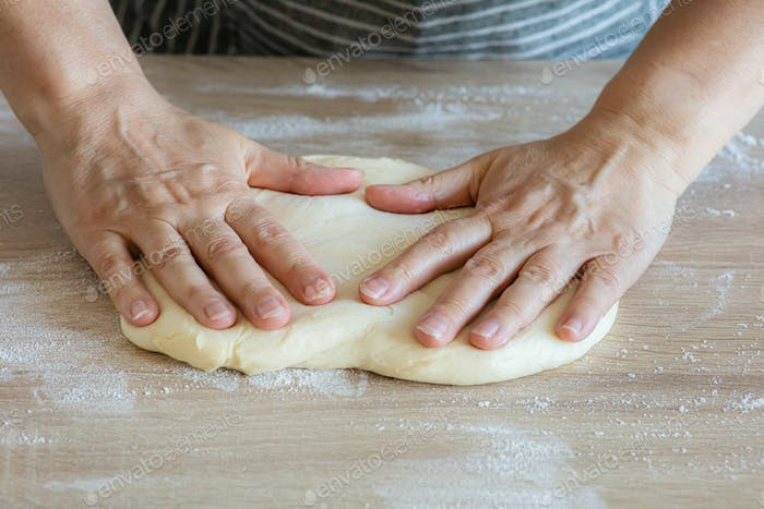 yeast dough and human arms