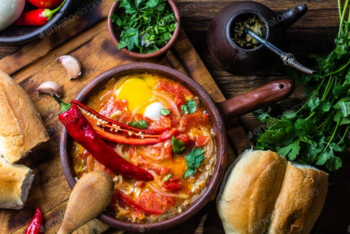 Chilean food. Picante caliente. Tomatoes, onion, chili fried with eggs