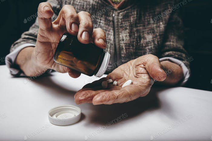 Elderly woman taking prescription medicine