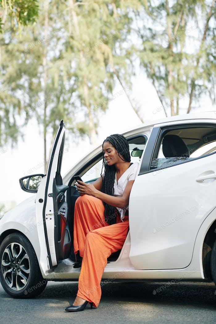 Female driver checking phone