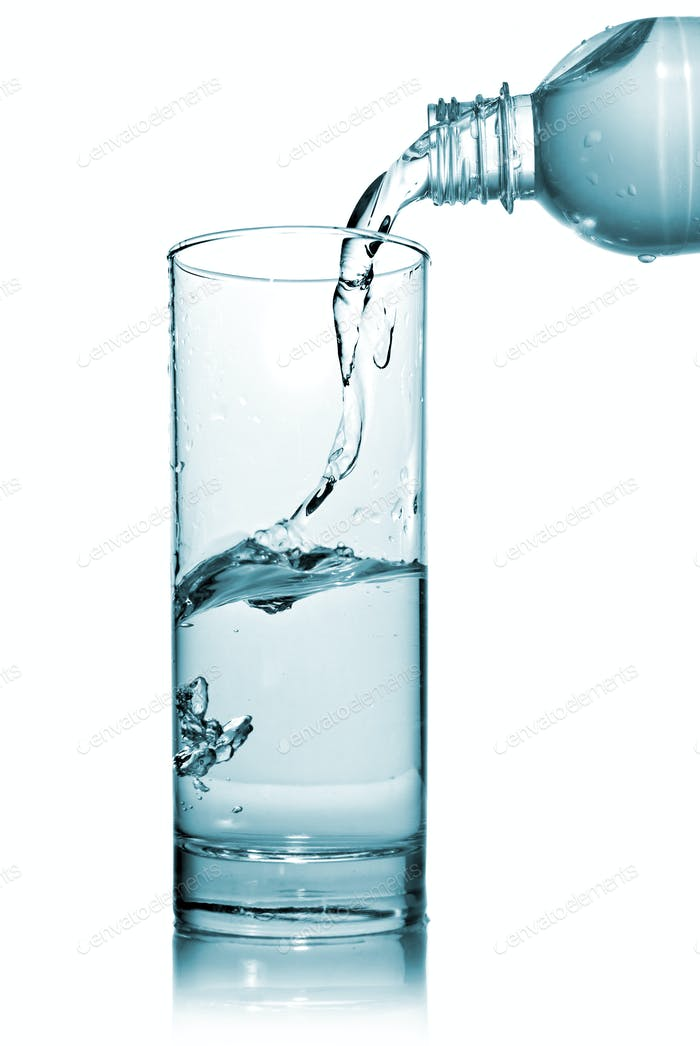 water pouring into glass from bottle isolated on white photo by