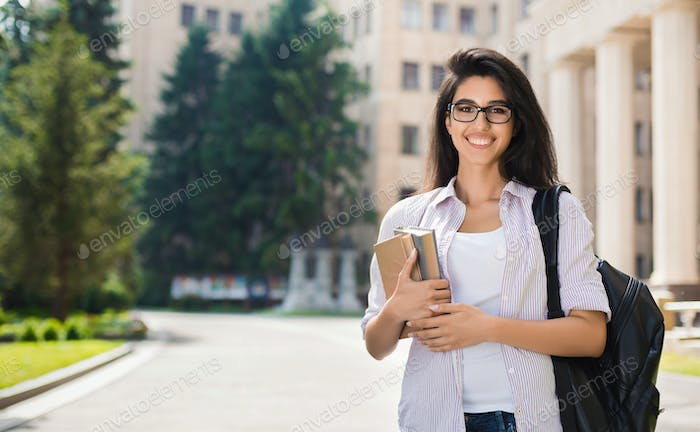 Smiling beautiful student girl outdoor