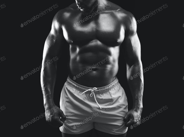 Super athletic black guy demonstrating naked muscular body