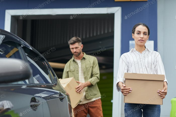 Couple Loading Boxes into Car