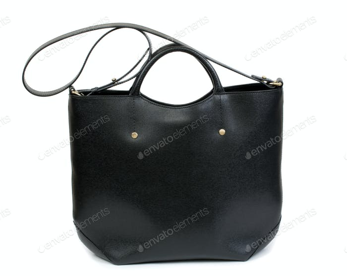 Elegant black female bag over white background