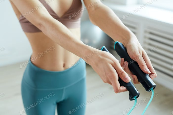 Young Woman Holding Skipping Rope Close up