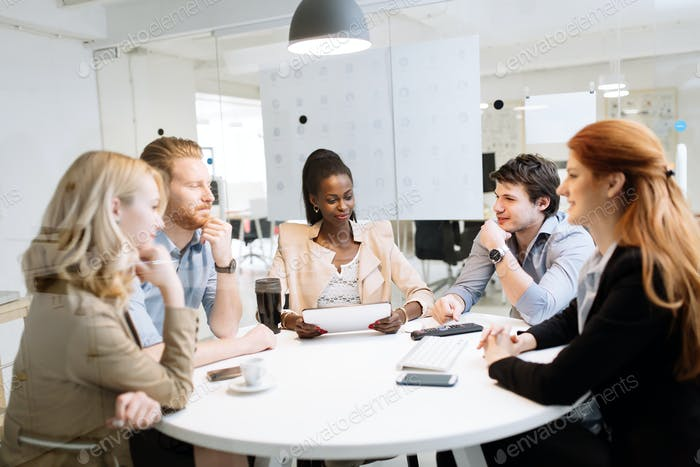 Group of business people sitting at desk