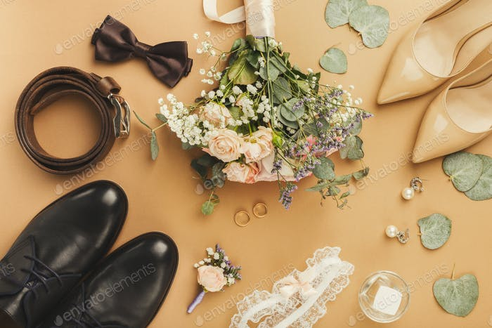 Top view of bride and groom shoes