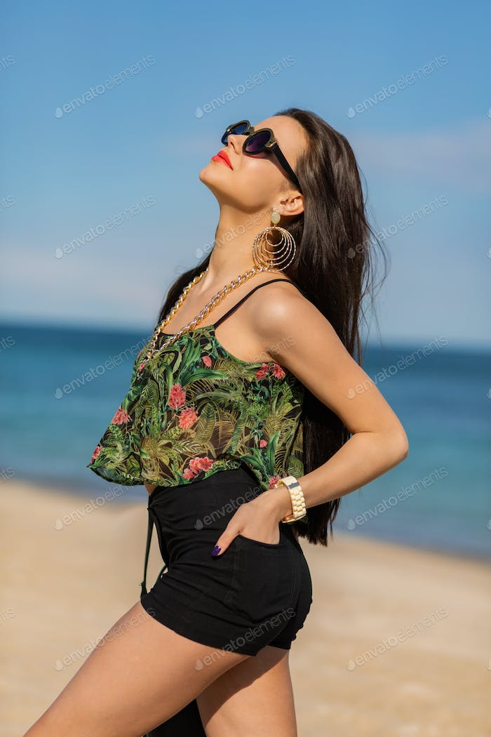 Perfect fit  girl  in trendy cool sunglasses   with  tan  body