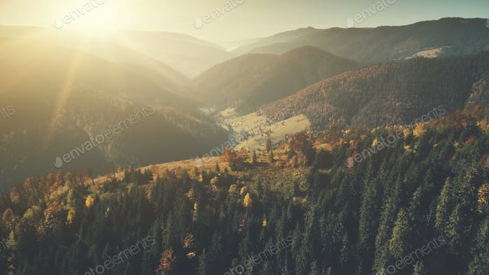 Panoramic hill chain scenery sun beam aerial view