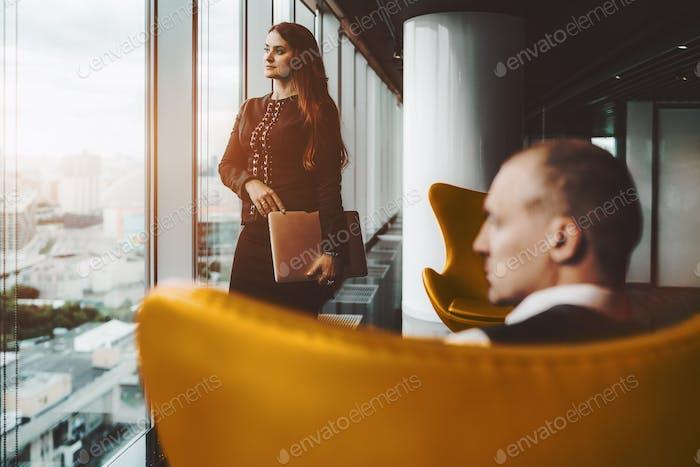 Business partners near the window