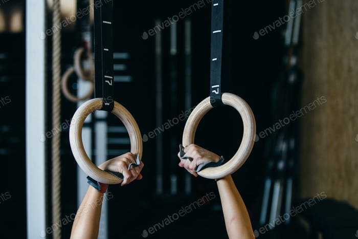 Girl doing deep rings exercise