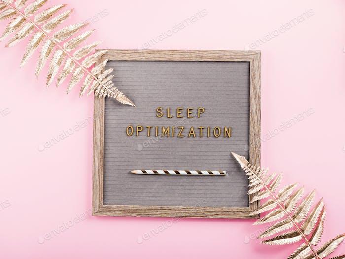 Sleep optimization text on letter board. Flat lay