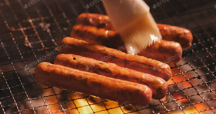 Honey apply on grill meat sausages