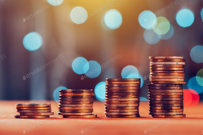 Money savings concept with coin stack
