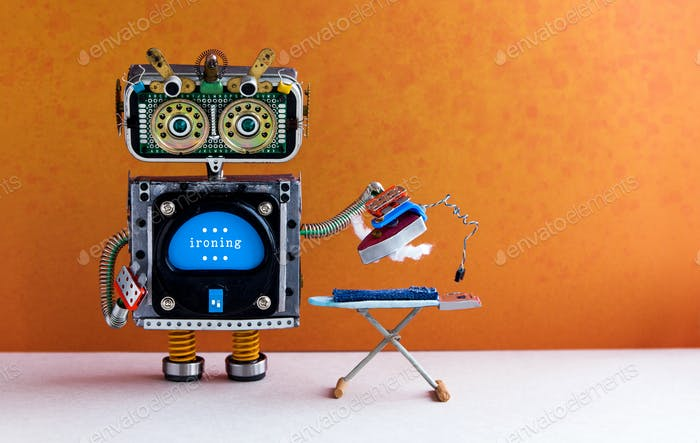 Robotic housework assistant ironing blue jeans with iron on the board.