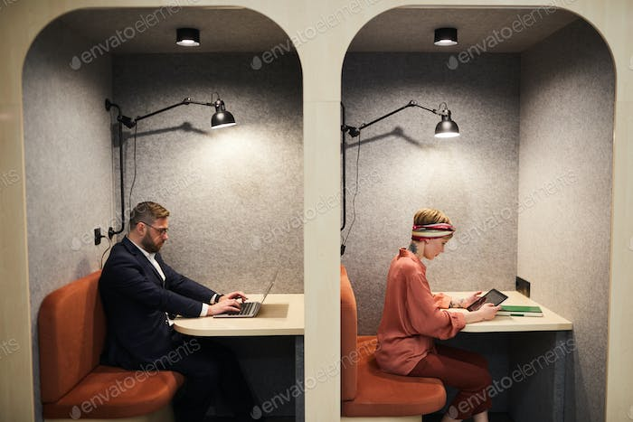 Two Business People Working in Cafe Booths