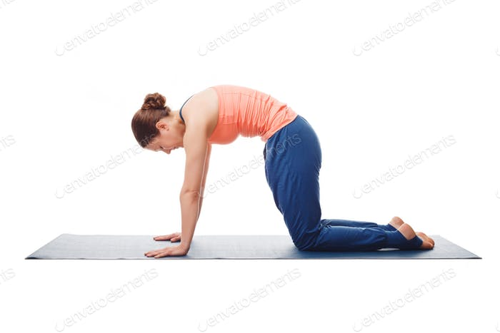Beautiful sporty fit yogini woman practices yoga asana marjarias